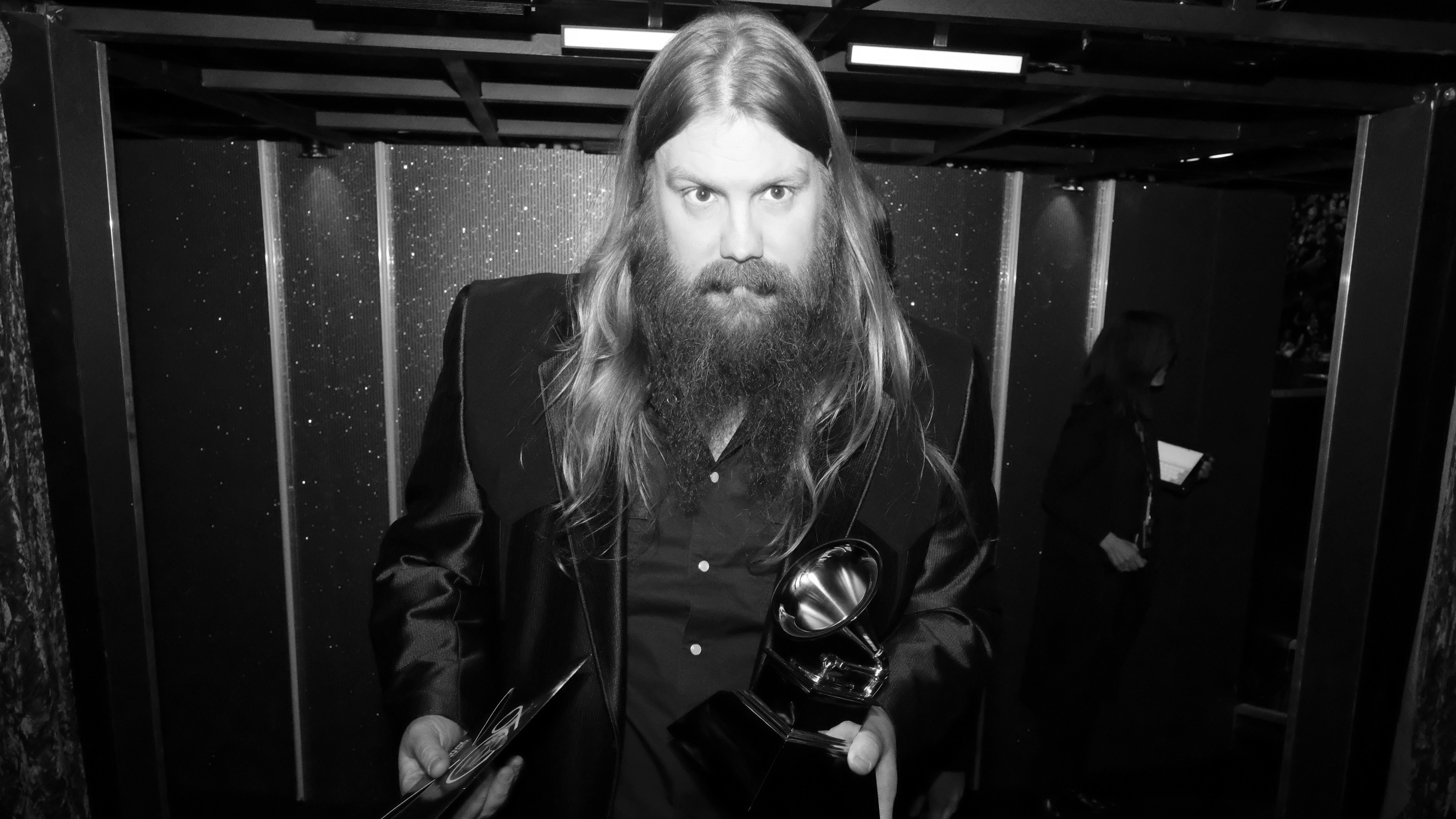 Chris Stapleton, who earned three 2018 GRAMMY trophies, holds his Best Country Album award backstage.