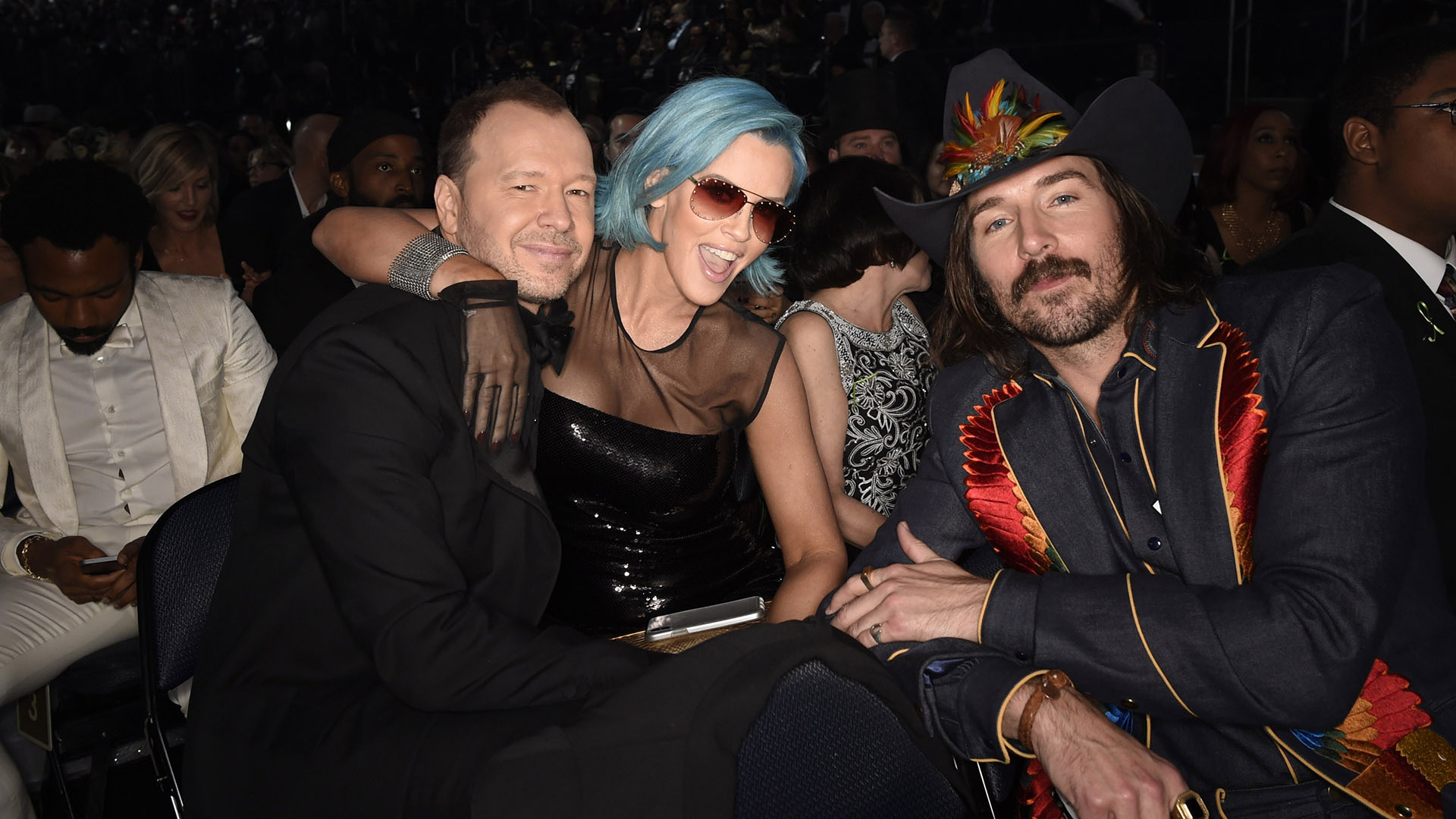 Blue Bloods star Donnie Wahlberg and his wife Jenny McCarthy strike a pose with Mark Wystrach from Midland.
