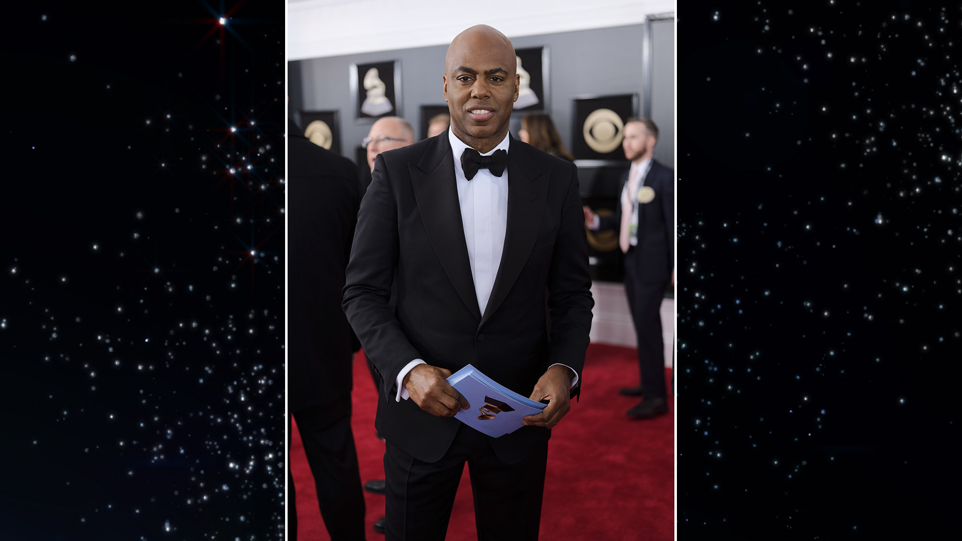 Entertainment Tonight host Kevin Frazier preps for a stream of interviews on the 60th Annual GRAMMY Awards red carpet.