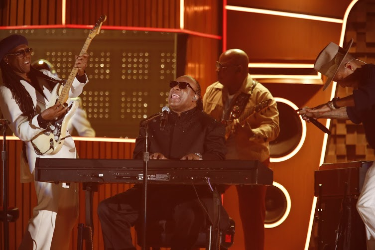 Stevie Wonder gets the audience on their feet.