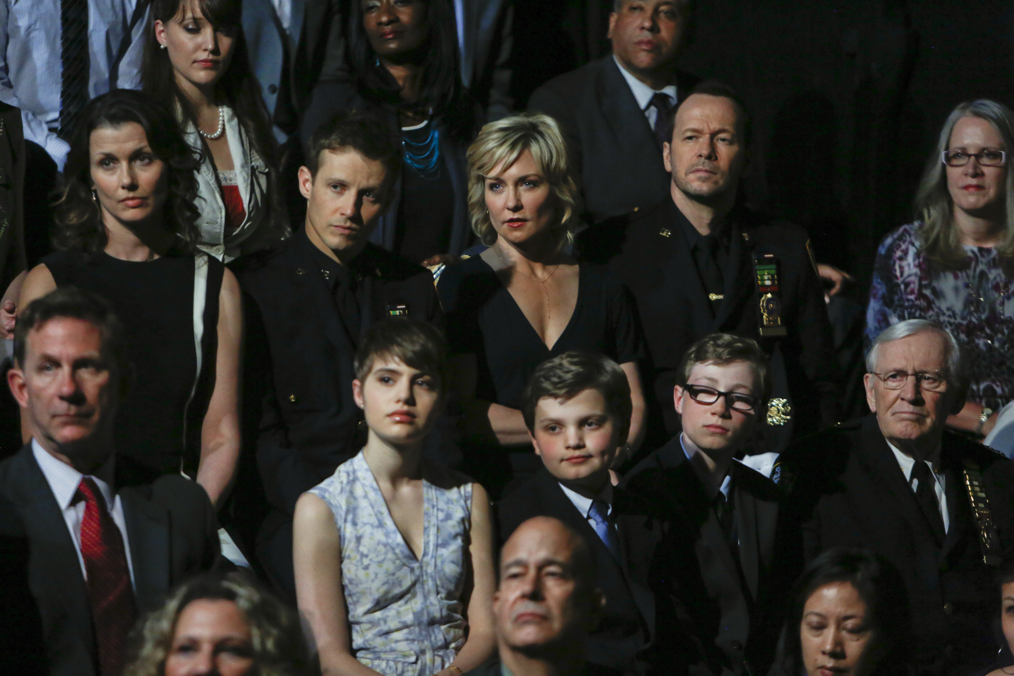 Notice how similar their listening faces are -- that's family.