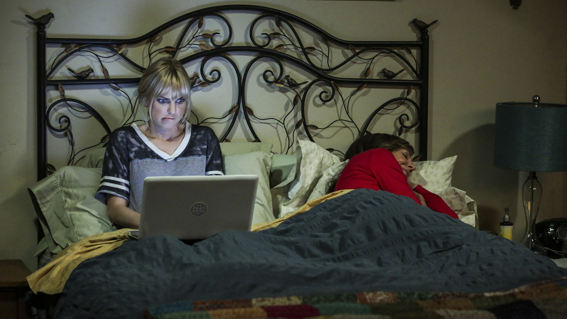 Christy indulges in a little late-night research while Bonnie tries to sleep.