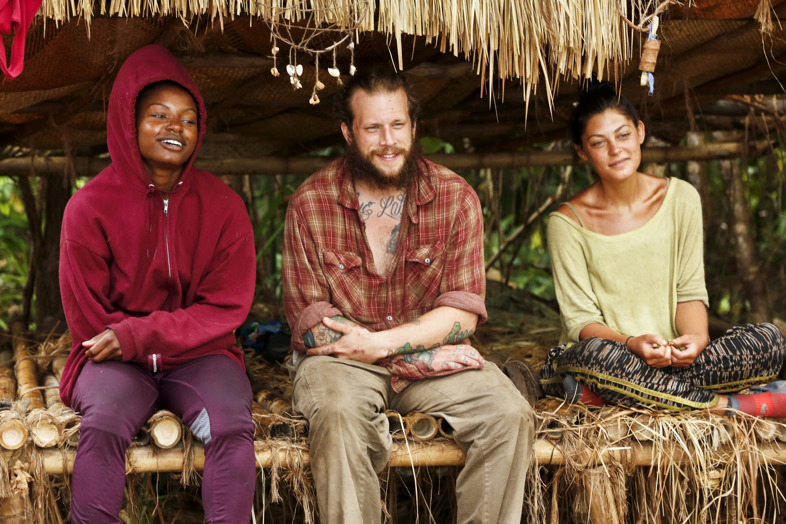 Cydney, Jason, and Michele hang out together under their makeshift shelter.