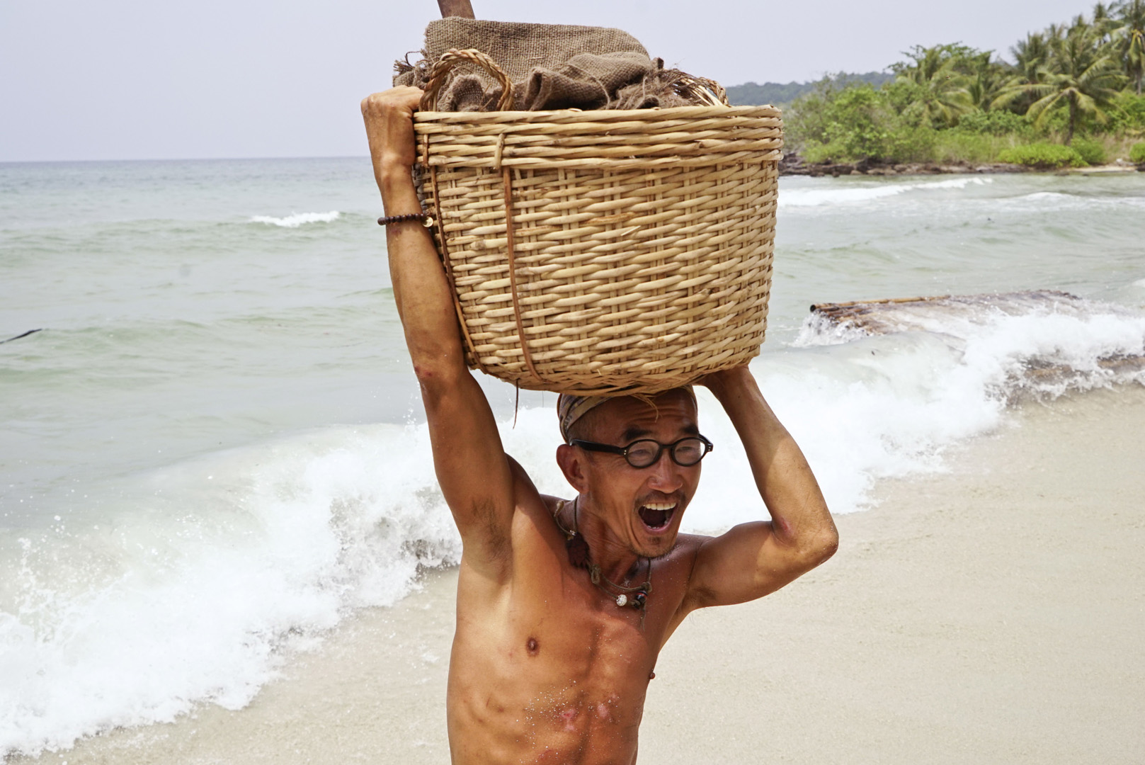 Tai helps carry supplies off the boat.