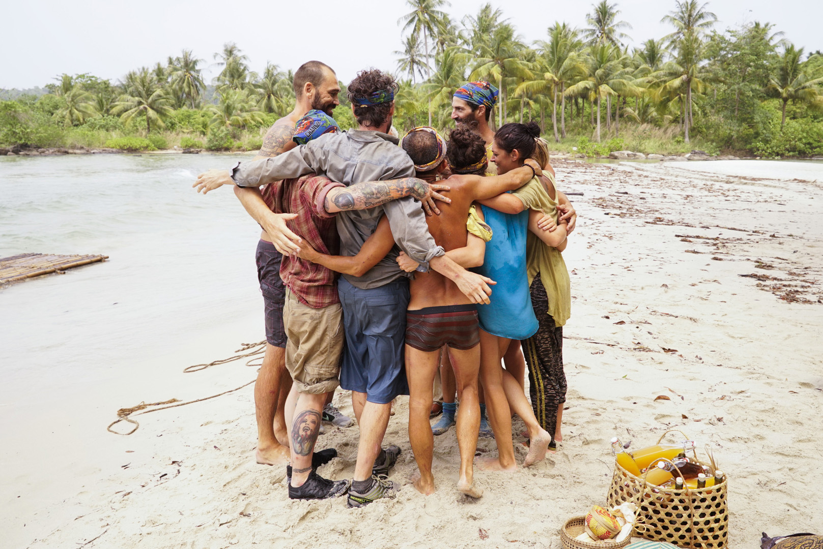 The castaways embrace before the game begins again.