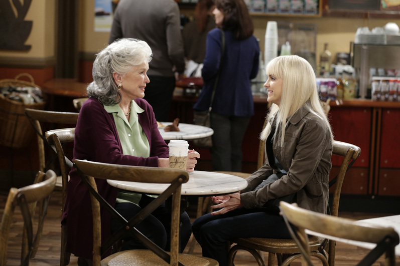 Christy and her grandmother have a chat over some coffee.