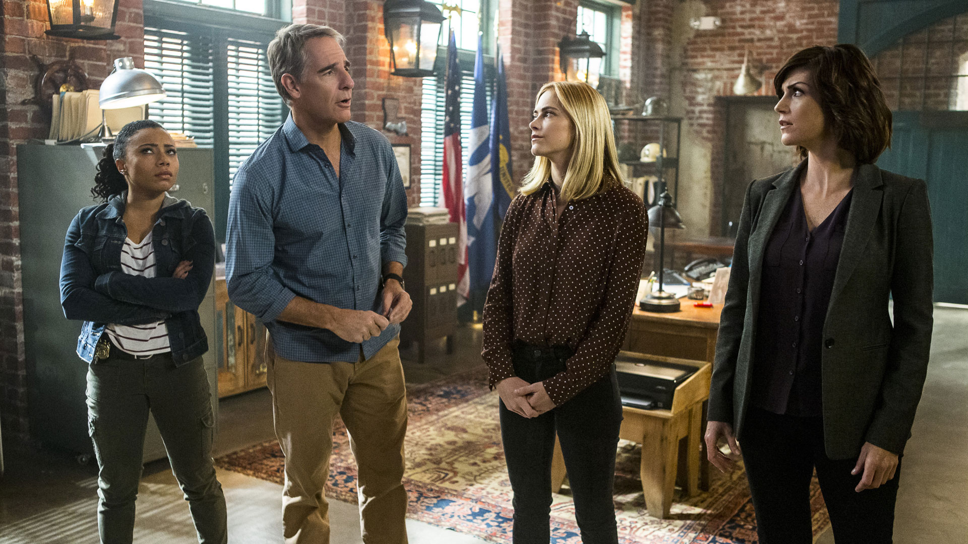 Shalita Grant as Sonja Percy, Scott Bakula as Agent Dwayne Pride, Emily Wickersham as Agent Ellie Bishop, and Zoe McLellan as Agent Meredith Brody