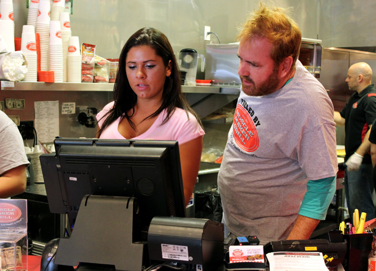 First up is Tim's assignment as a Muscle Maker Grill cashier.