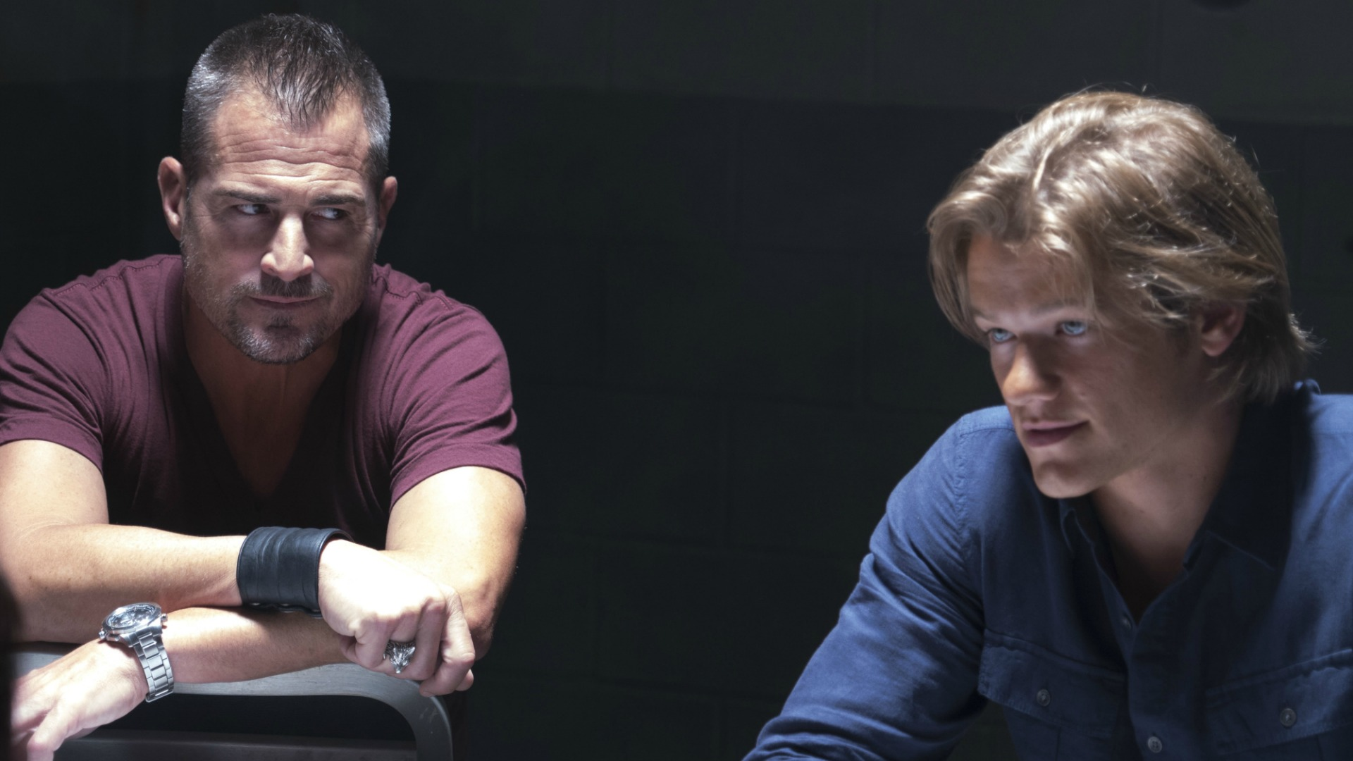 Jack and MacGyver sit down for an interrogation.