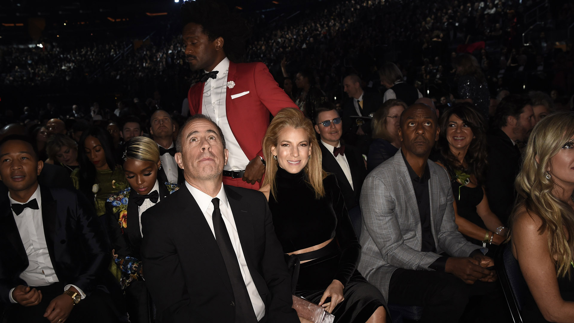 Comedian and 2018 GRAMMY nominee Jerry Seinfeld looks up, while his wife, Jessica, gives the camera a big grin.