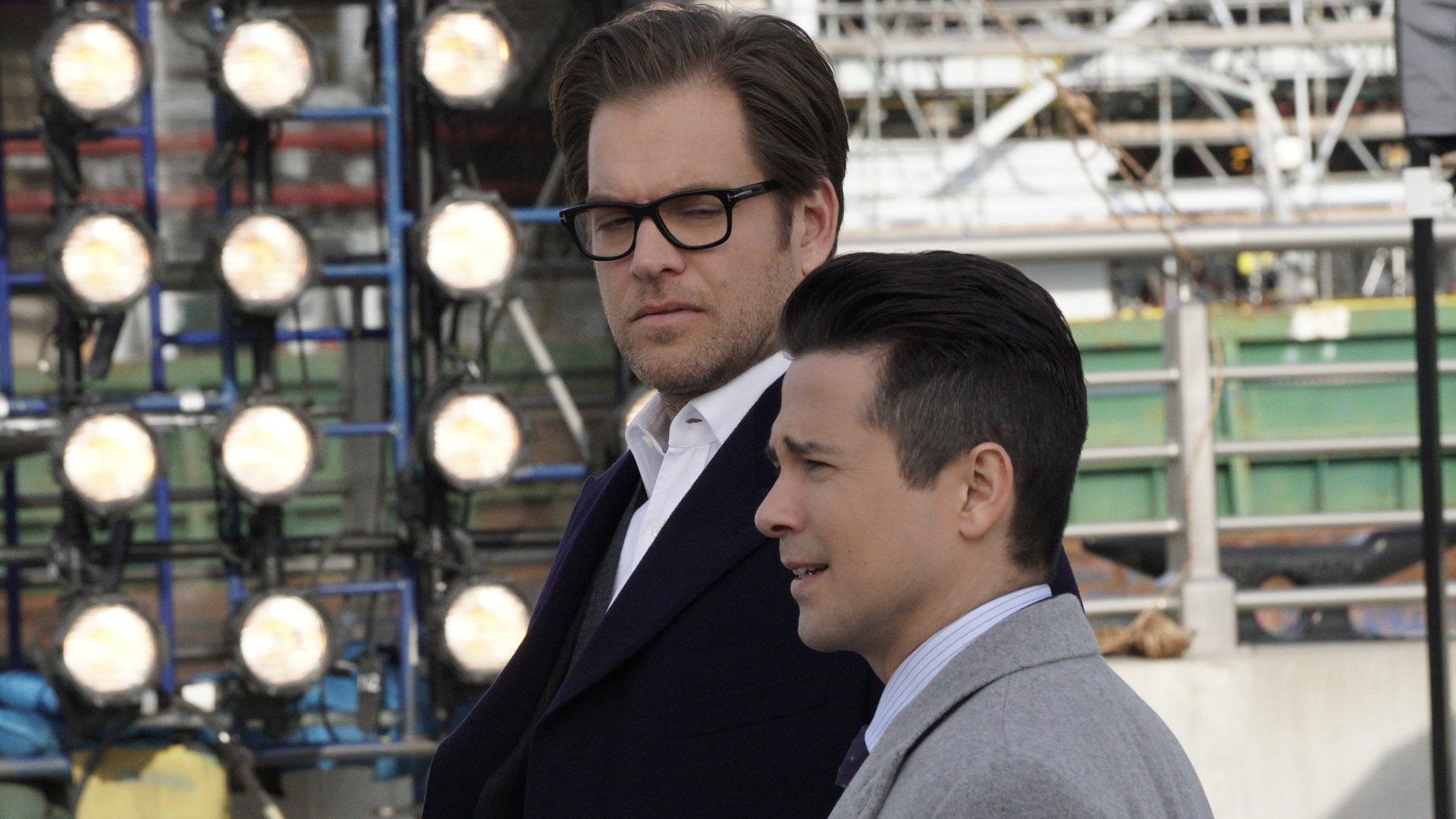 Bull and Benny discuss the case.