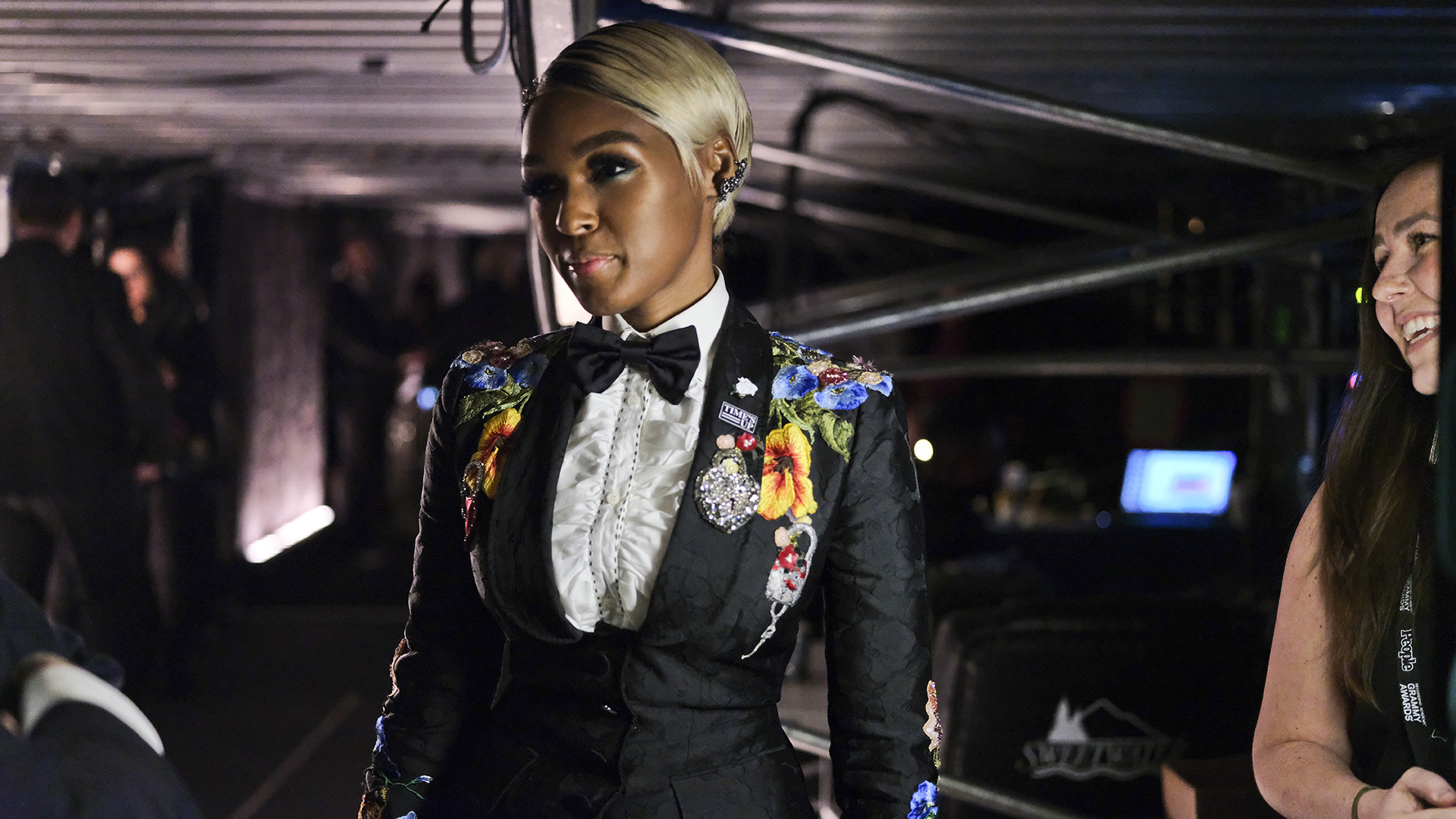 Singer-actress Janelle Monáe, who gave an inspiring speech at the 60th Annual GRAMMY Awards, offers a small smile in her stunning floral tux.