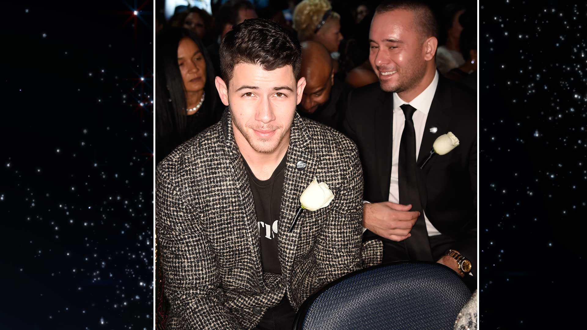Nick Jonas, who presented at the 2018 GRAMMY Awards, offers a come-hither glance from his seat at Madison Square Garden.
