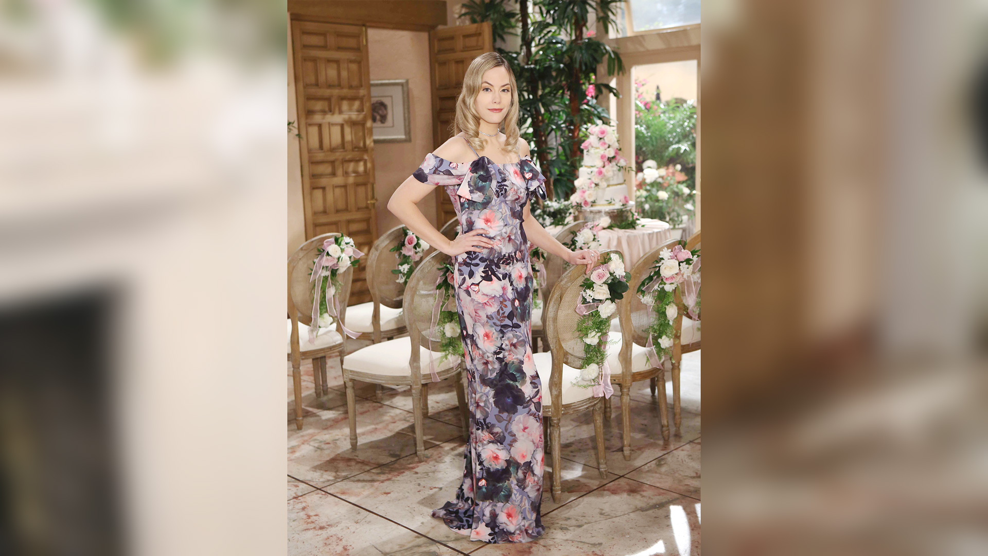 Hope Logan (Annika Noelle) in a flowy, foral dress.