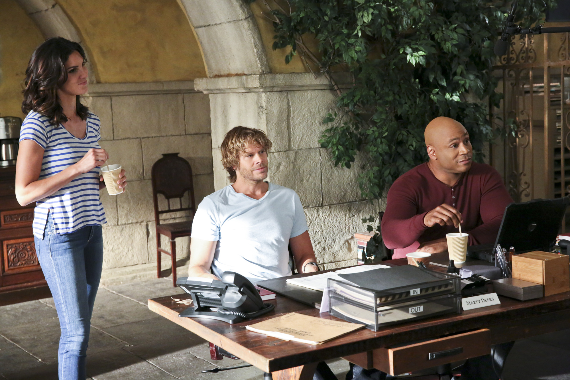 Daniela Ruah as Special Agent Kensi Blye, Eric Christian Olsen as LAPD Liaison Marty Deeks, and LL COOL J as Special Agent Sam Hanna.