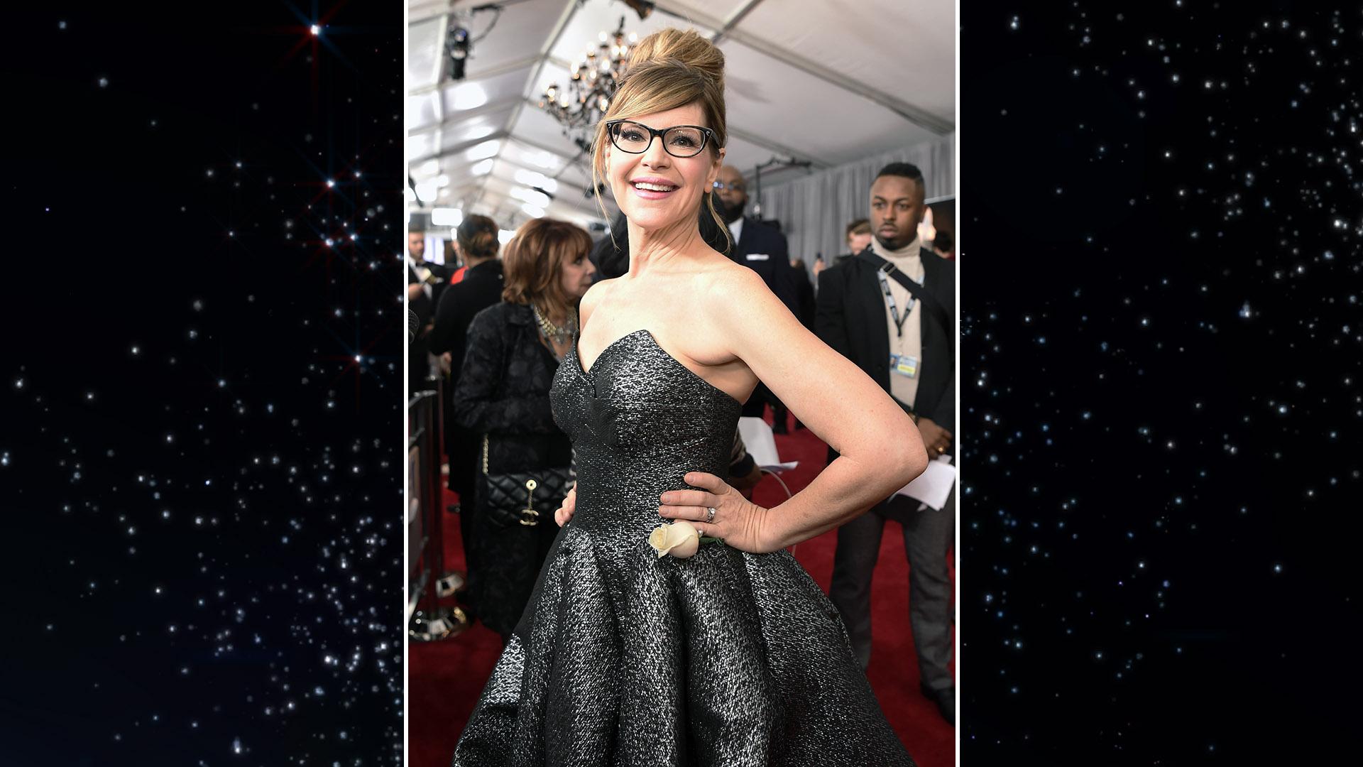 Singer Lisa Loeb celebrates her Best Children's Album win in a shimmery gray ball gown.