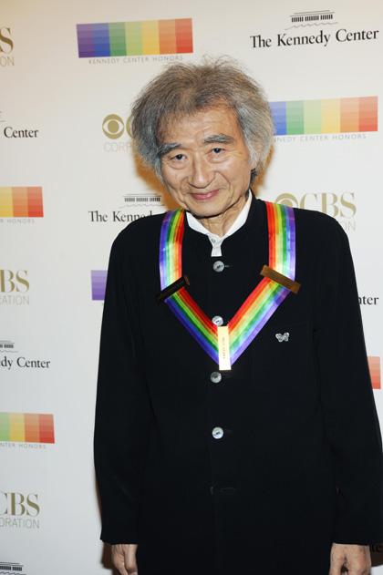 Conductor Seiji Ozawa looks soulfully into the camera.