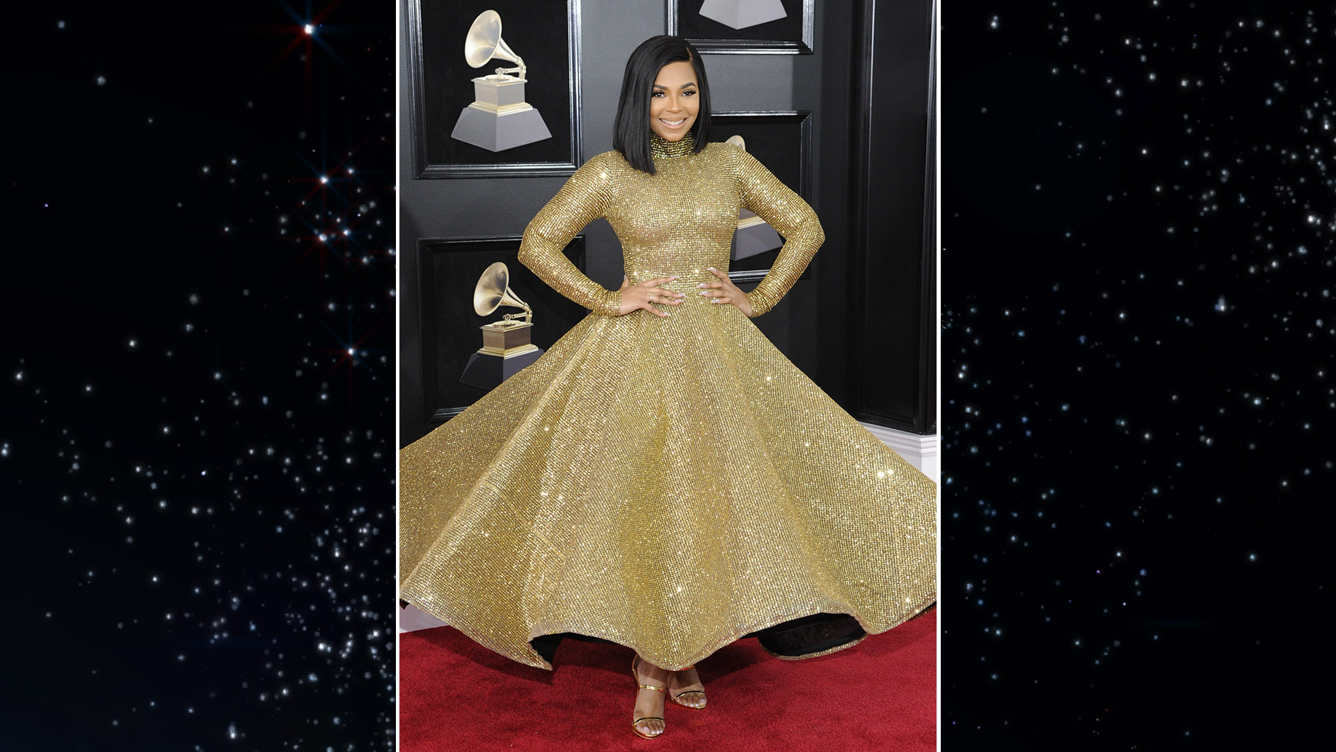 Ashanti twirls in a high-necked, long-sleeved pale gold gown with a full skirt on the red carpet.