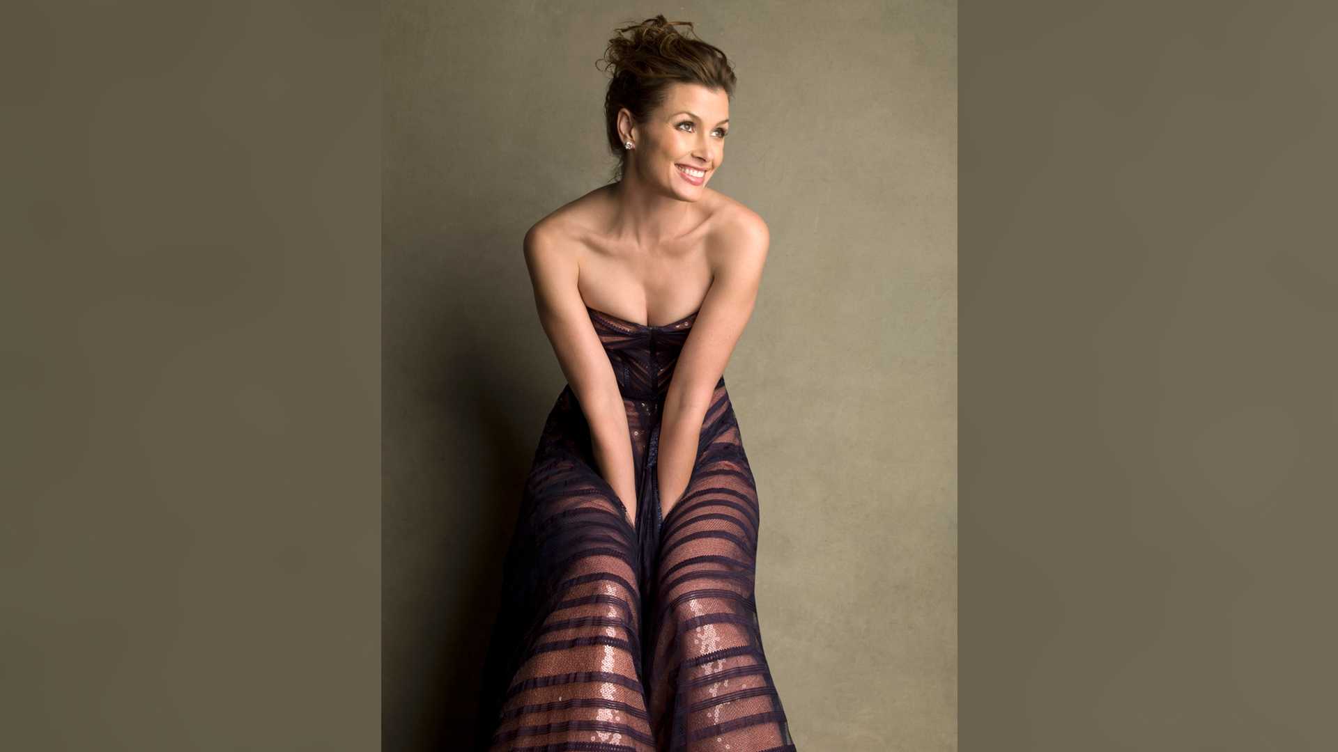 Bridget Moynahan, wearing a gorgeous gown—and grin