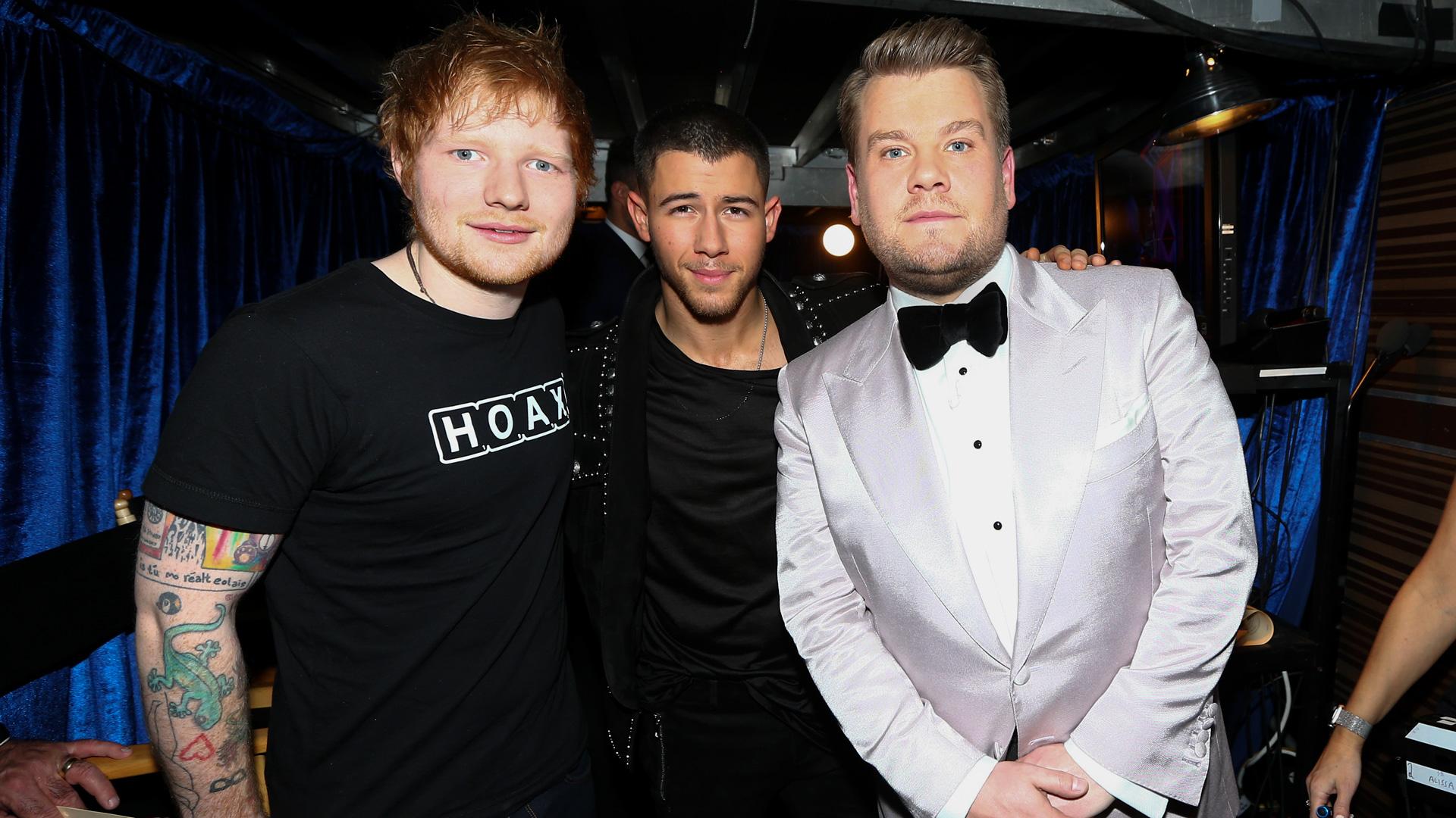 Ed Sheeran and Nick Jonas join 2017 GRAMMY host James Corden backstage.