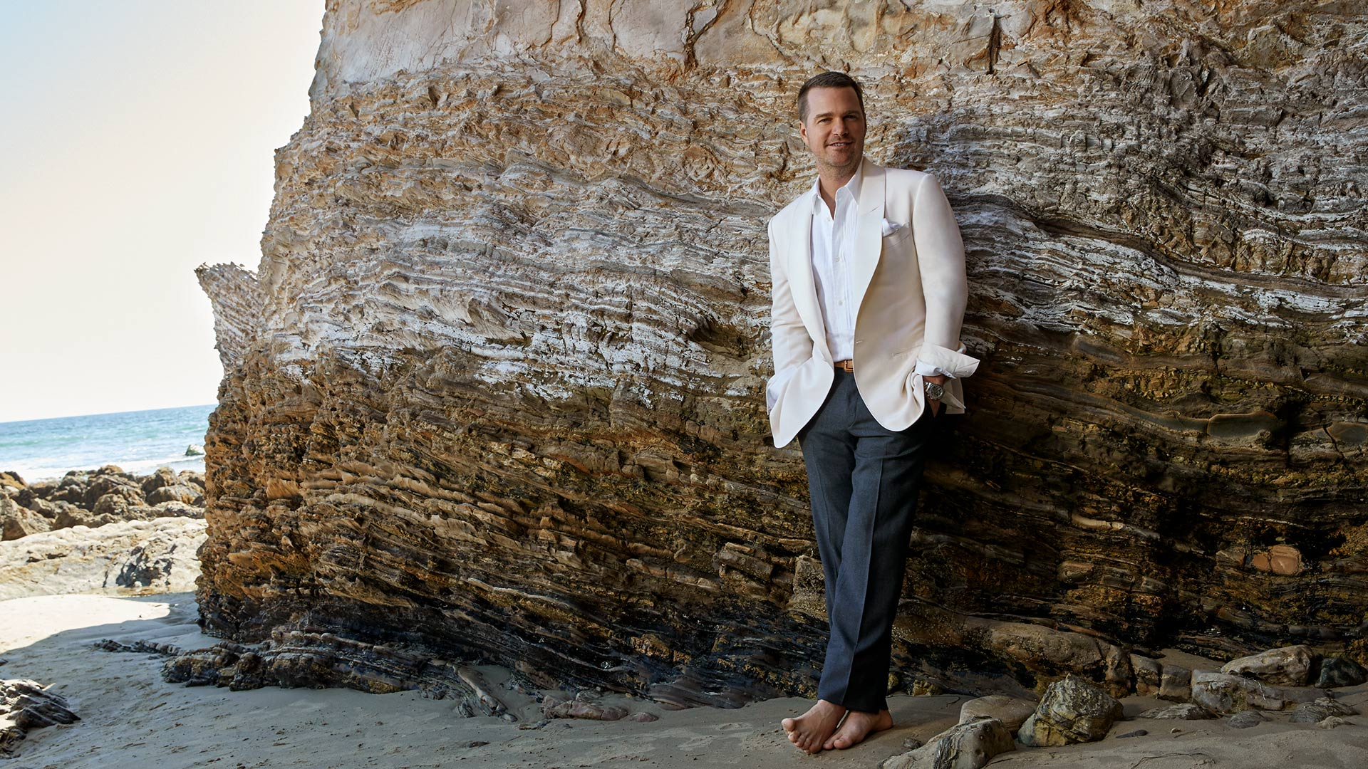 Chris O'Donnell puts his toes in the sand