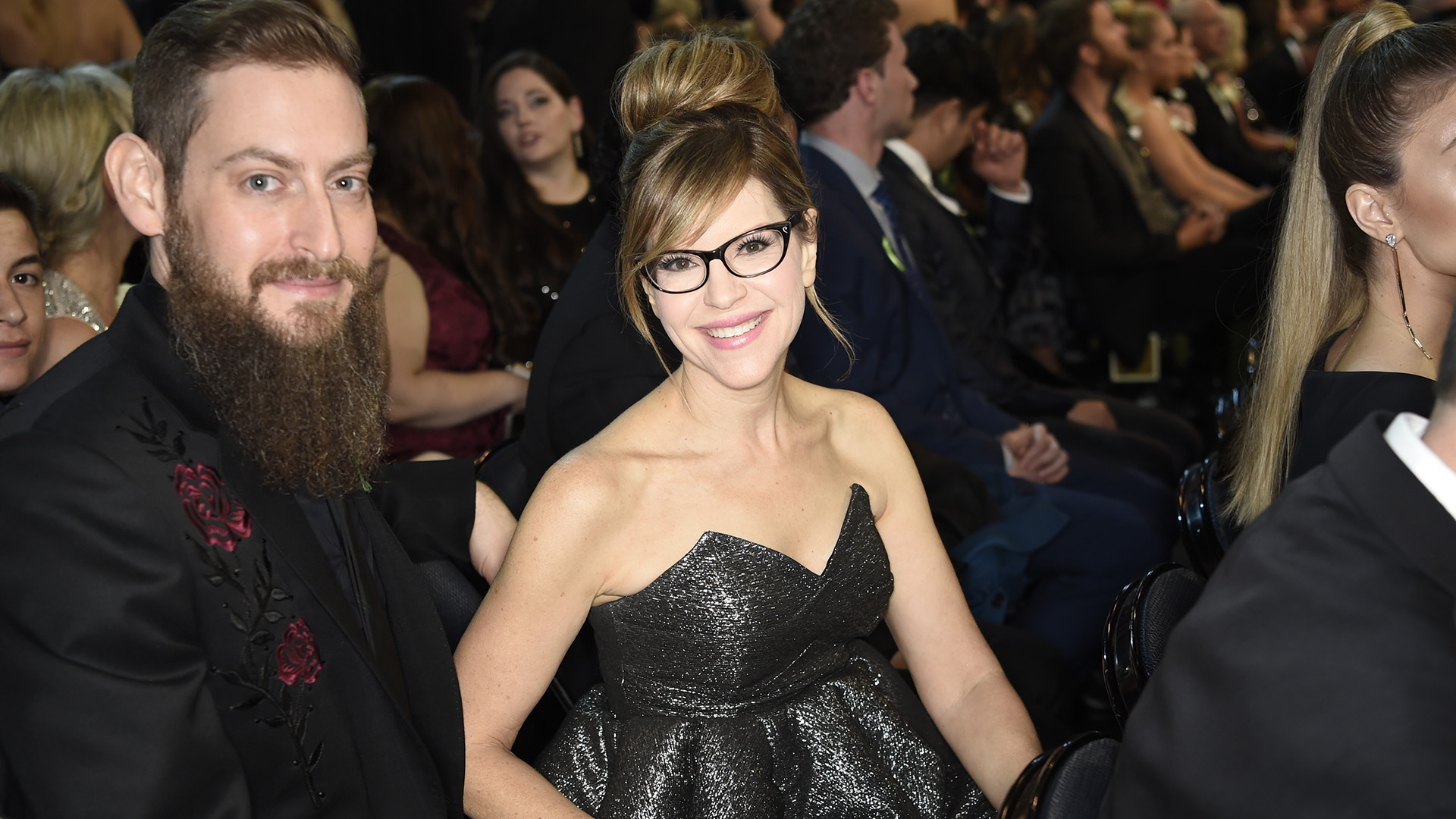 Lisa Loeb, who took home a 2018 GRAMMY for Best Children's Album, smiles alongside her husband, Roey Hershkovitz.