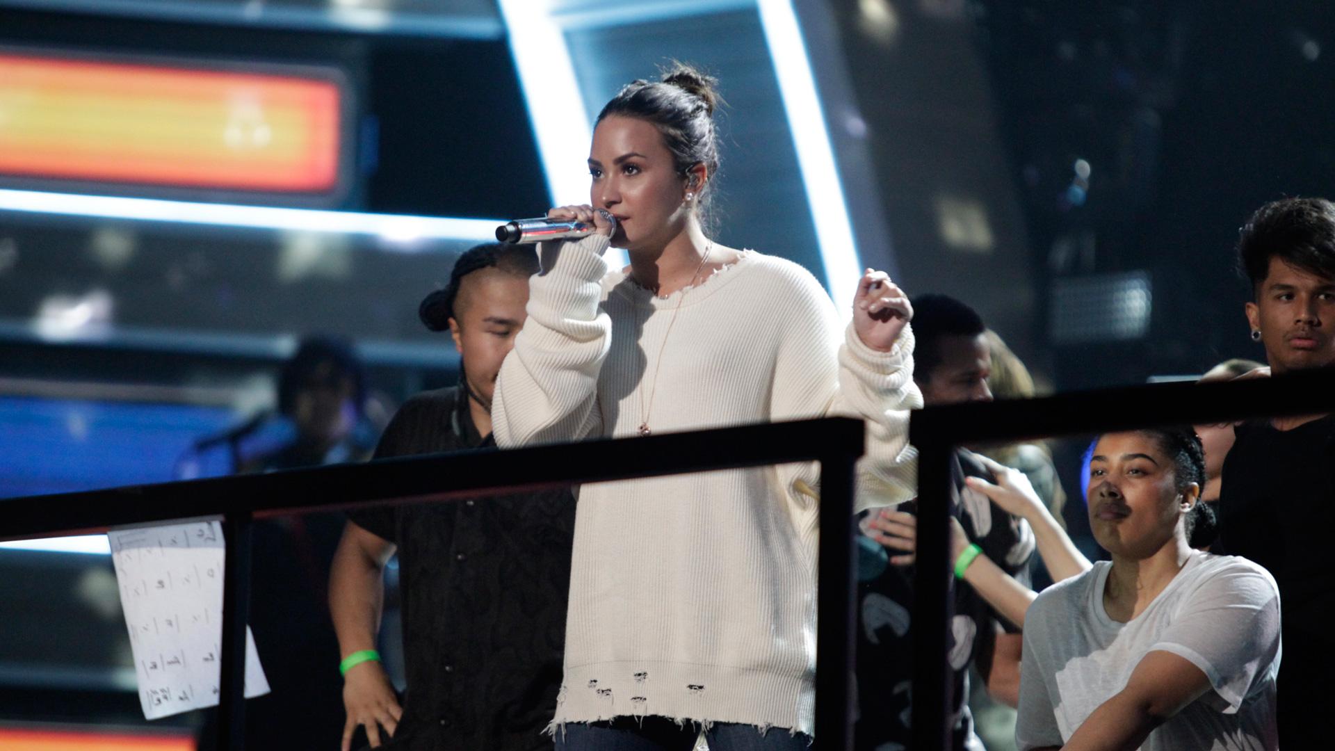Best Pop Vocal Album nominee Demi Lovato rehearses in a cozy white sweater.
