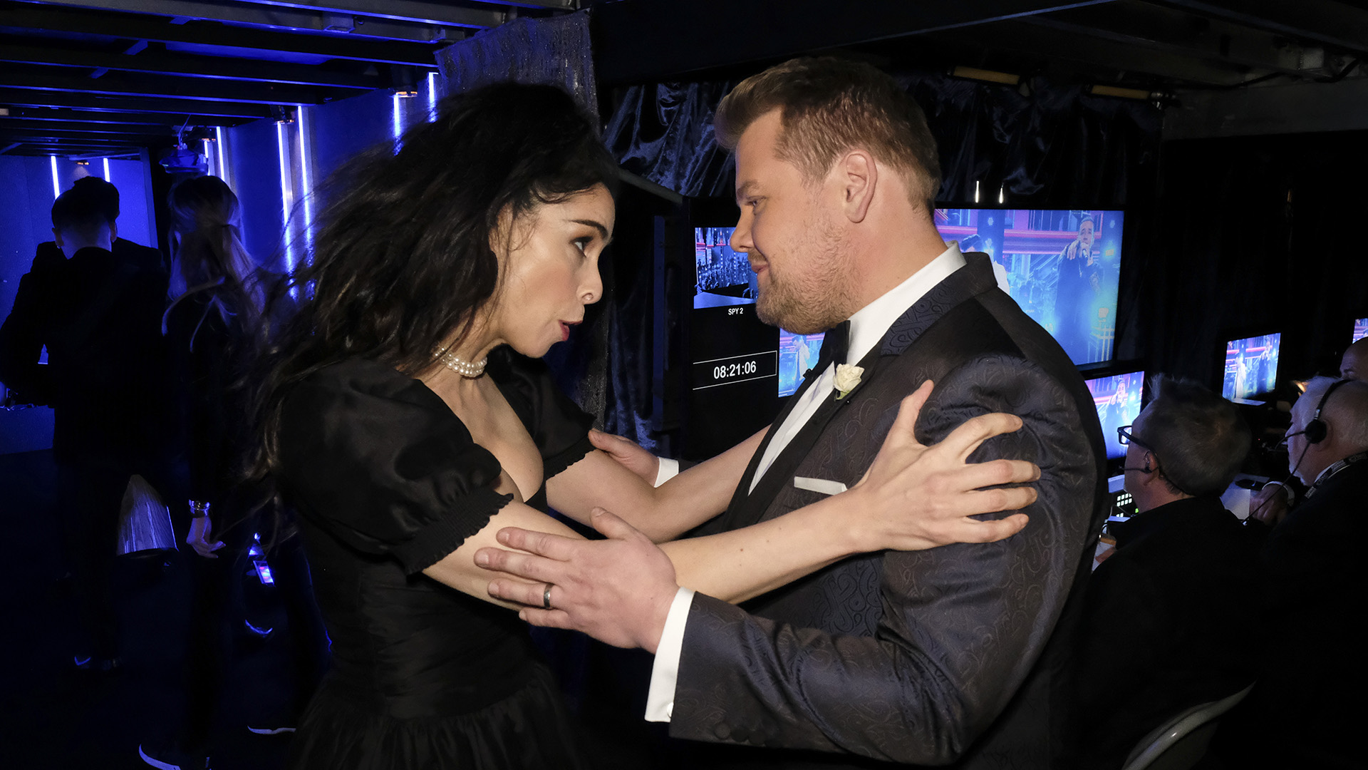 Comedian and Best Comedy Album nominee Sarah Silverman clutches host James Corden by the shoulders backstage at Madison Square Garden.