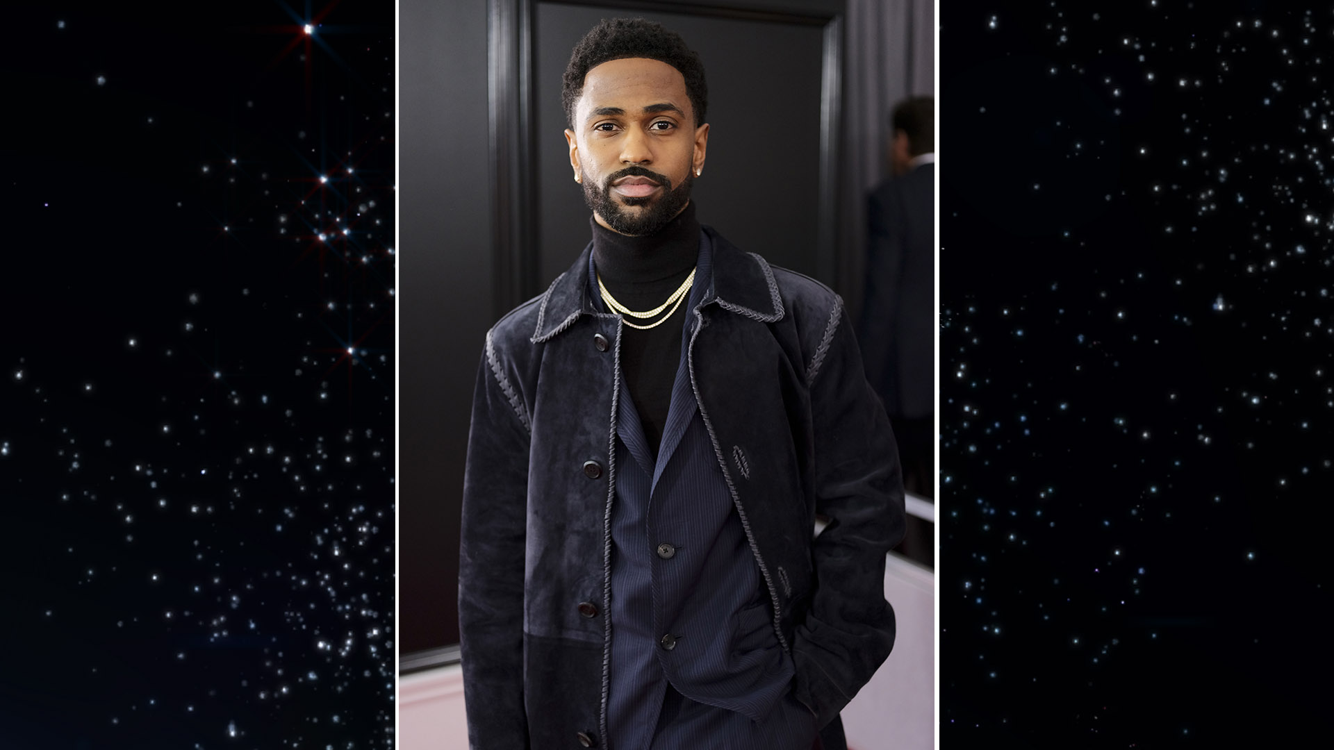 Best Rap Performance nominee Big Sean throws a dark blue-green velvet trench over a navy suit.