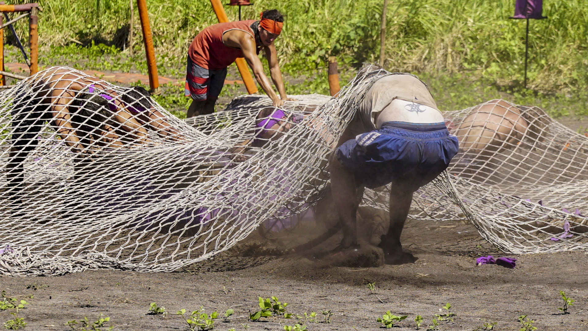 Dragging a box underneath a net is no easy task.