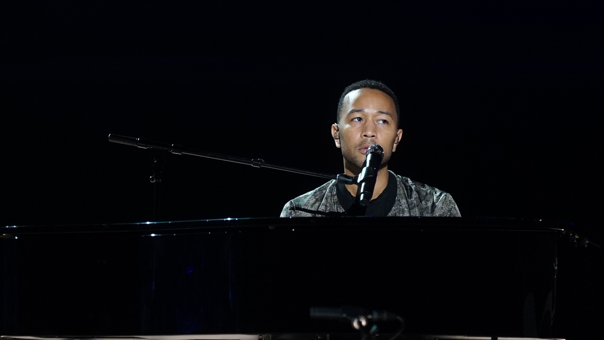 Soulful singer John Legend sits at his piano to practice before his special 2017 GRAMMY performance.