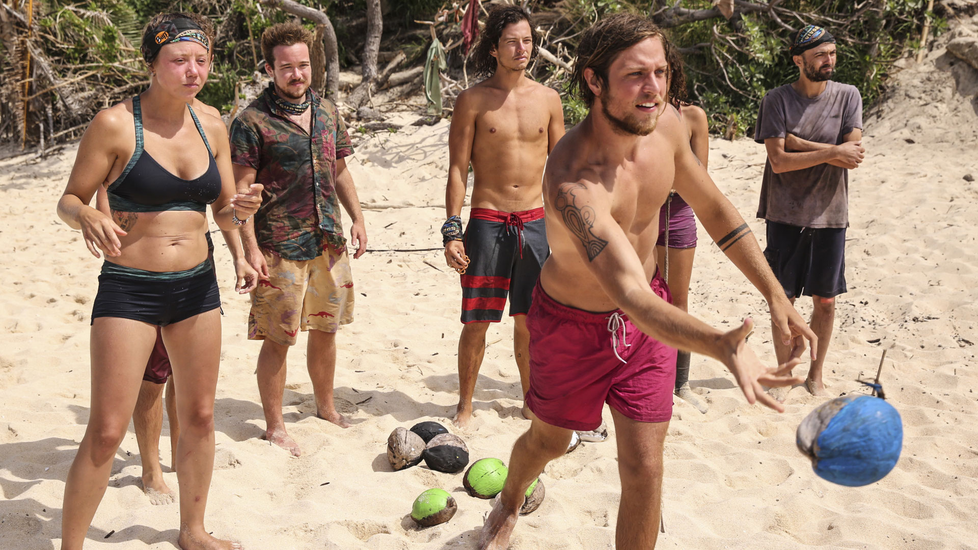 Taylor takes a toss while his tribe mates watch.
