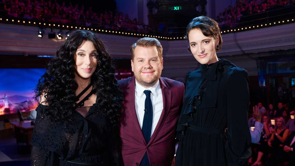 Cher, James Corden, and Phoebe Waller-Bridge pose for a group shot.