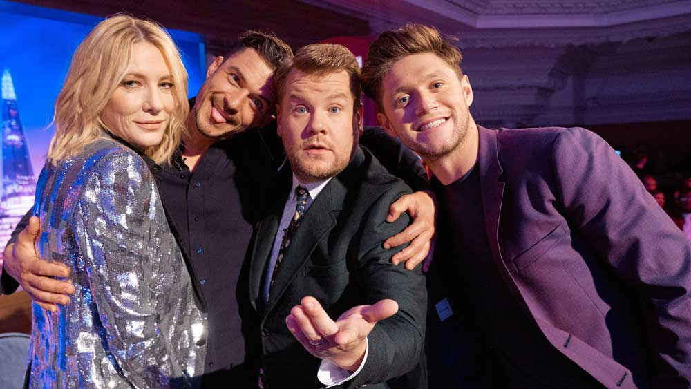 Cate Blanchett, Orlando Bloom, James Corden, and Niall Horan pose for a group shot.