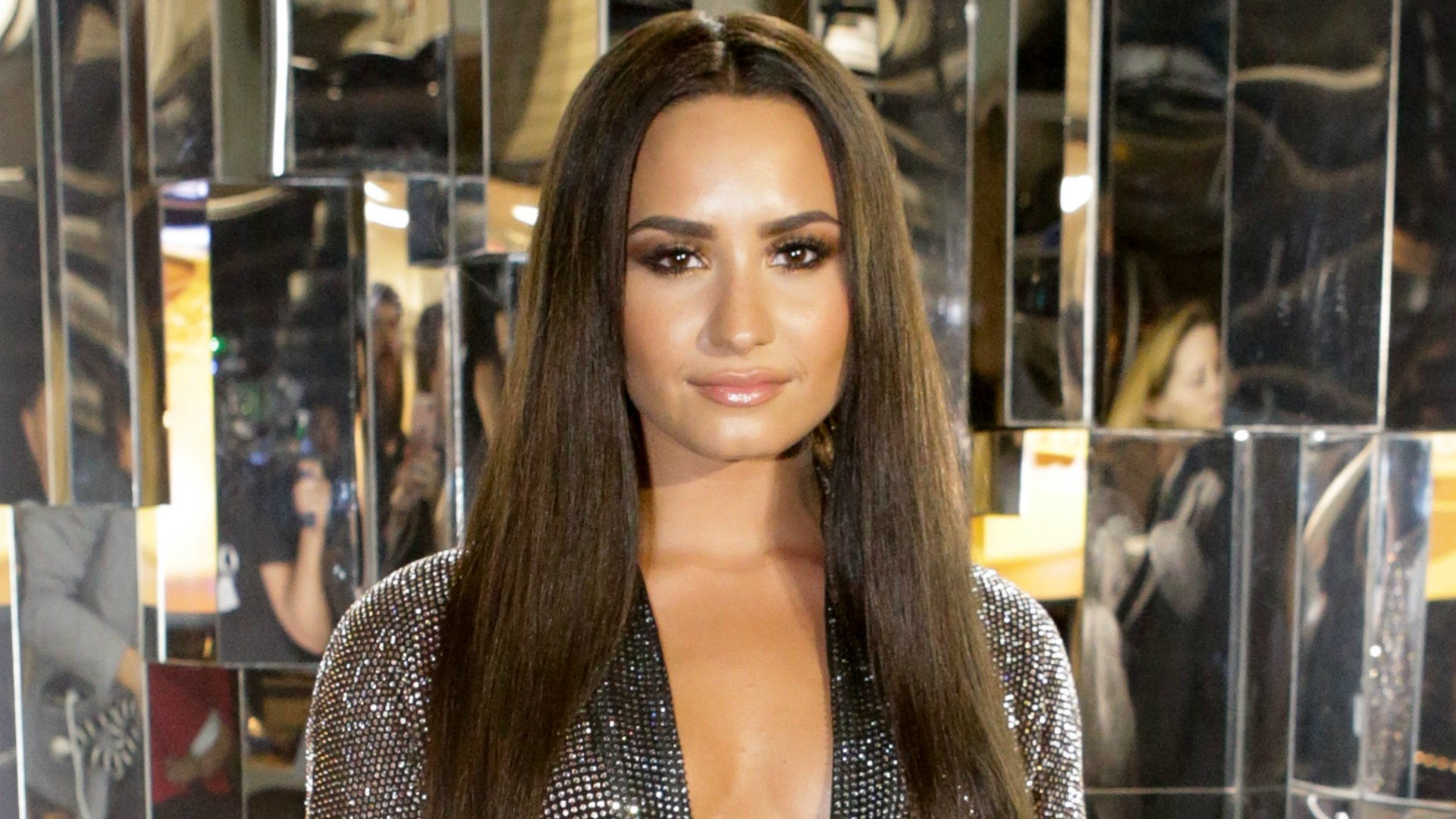 Demi Lovato rocks a super-sleek look before performing in The Bee Gees tribute.