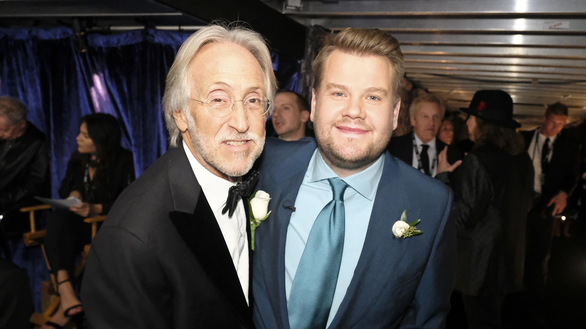 James Corden smiles for the camera with Recording Academy president Neil Portnow.