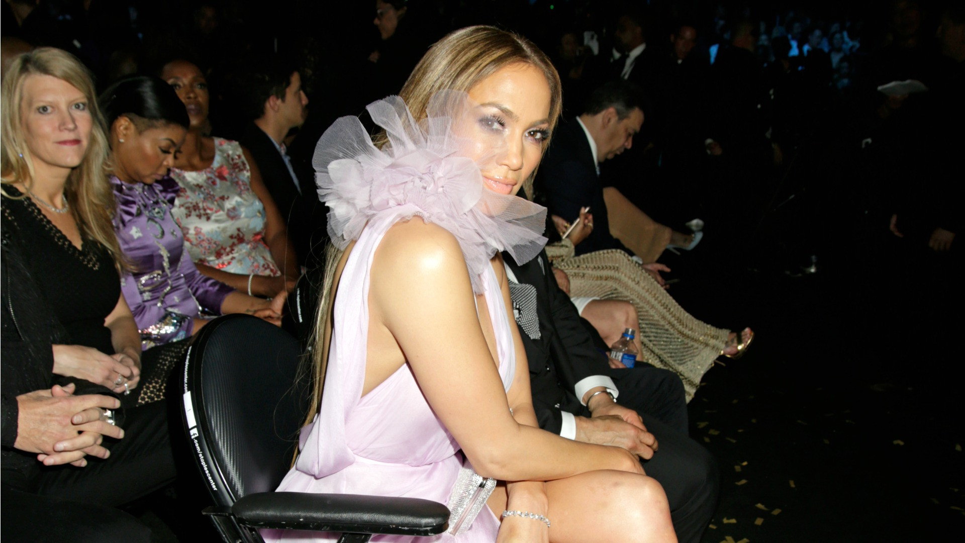 Peekaboo! We see you, Jennifer Lopez, even if you try hiding behind your pink tulle neckline.
