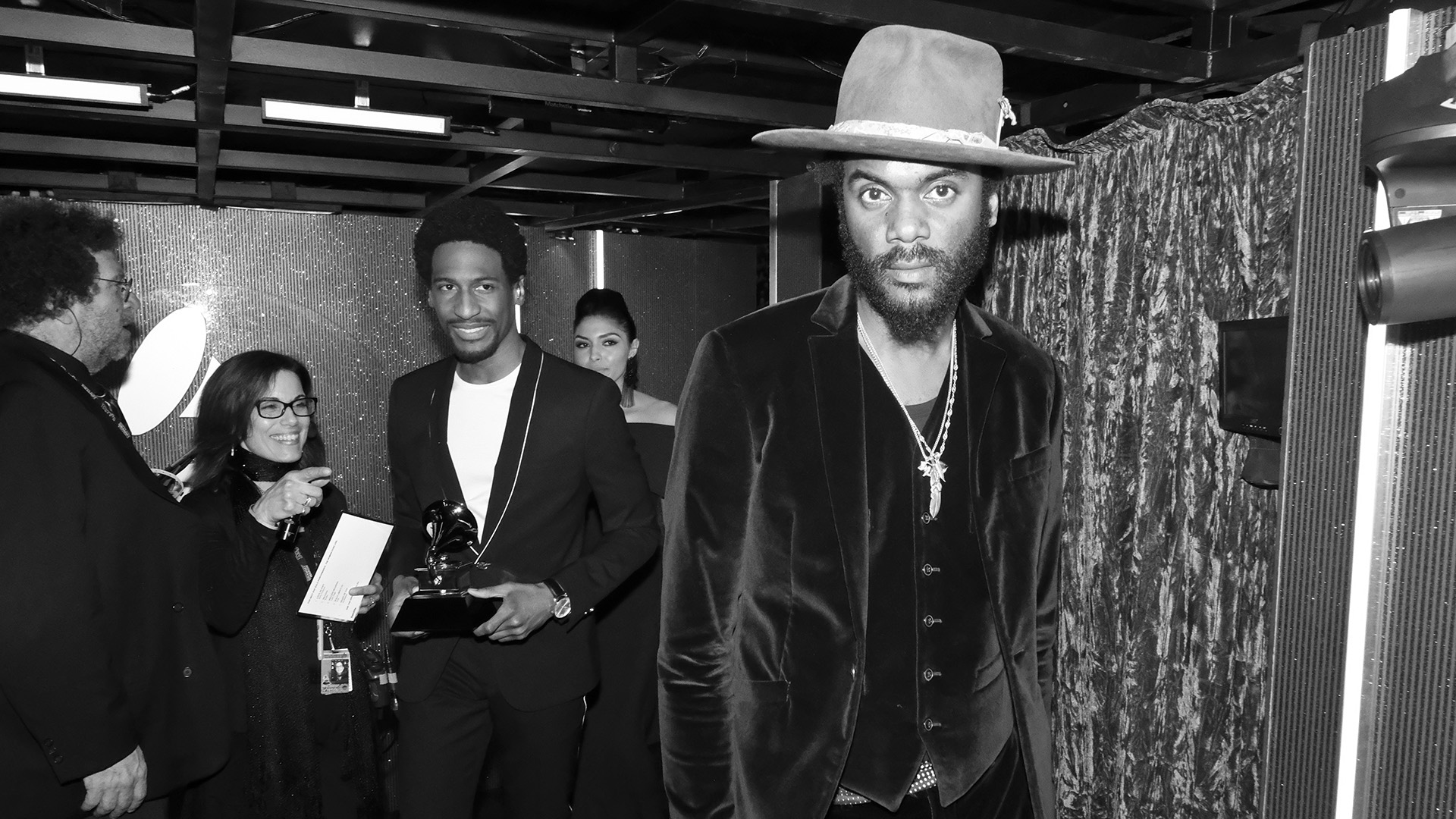 Presenters and performers Gary Clark Jr. and Jon Batiste walk backstage after accepting Ed Sheeran's GRAMMY for Best Pop Solo Performance.