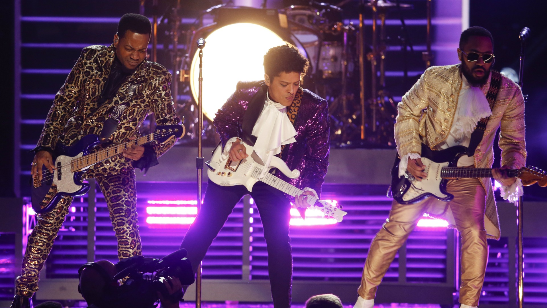 Bruno Mars donned a purple suit during his performance of