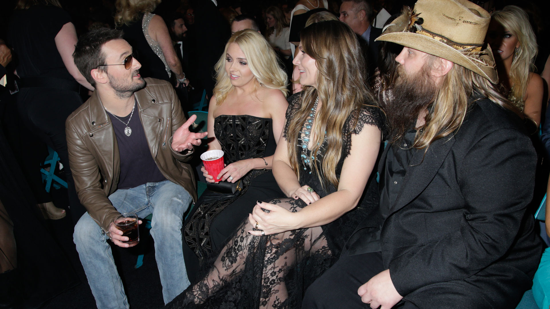 Eric Church and his wife chat with Chris and Morgane Stapleton during a commercial break.