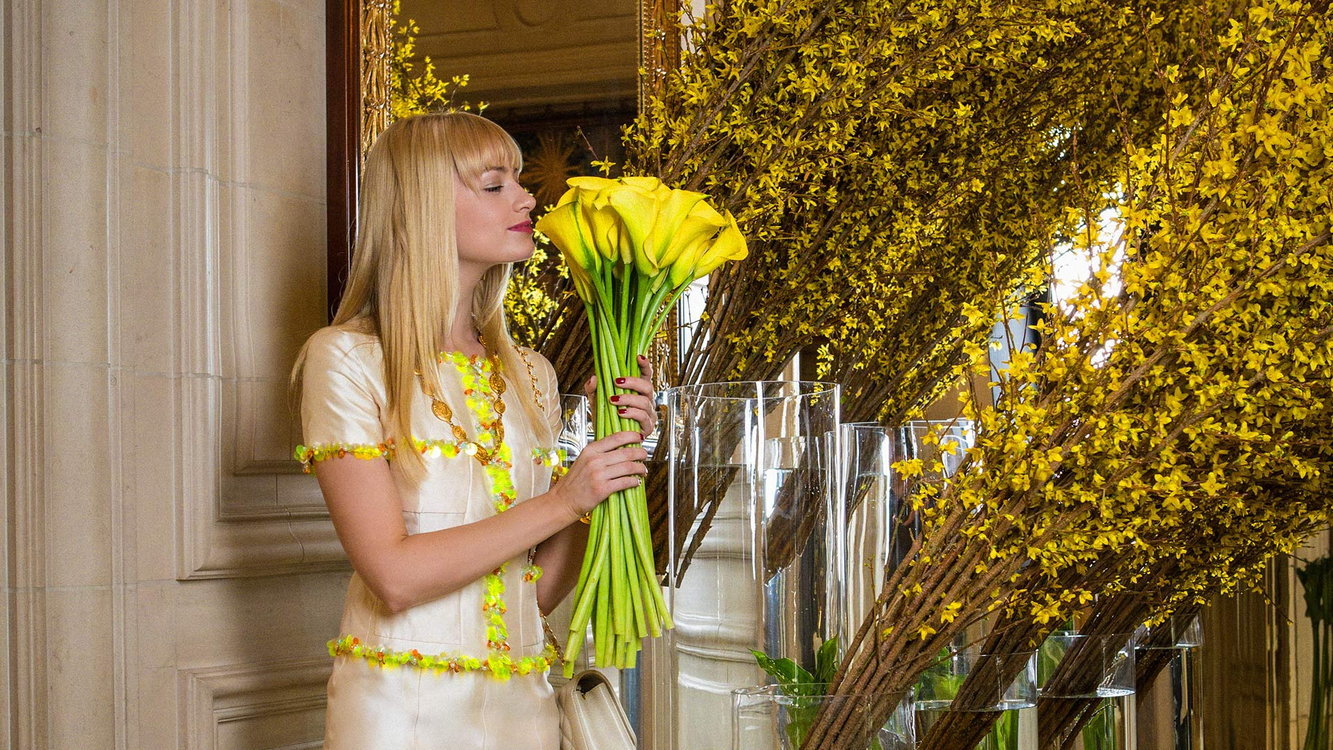 Beth Behrs stops to smell the flowers