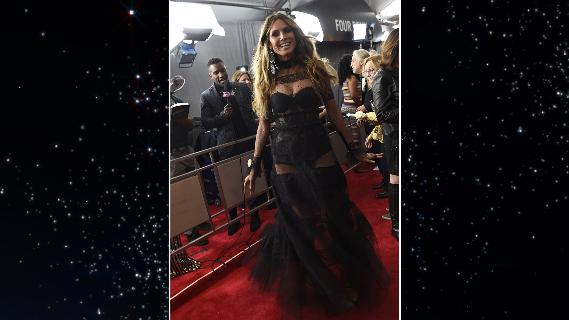 Model and TV personality Heidi Klum sashays down the red carpet in a see-through black lace gown.