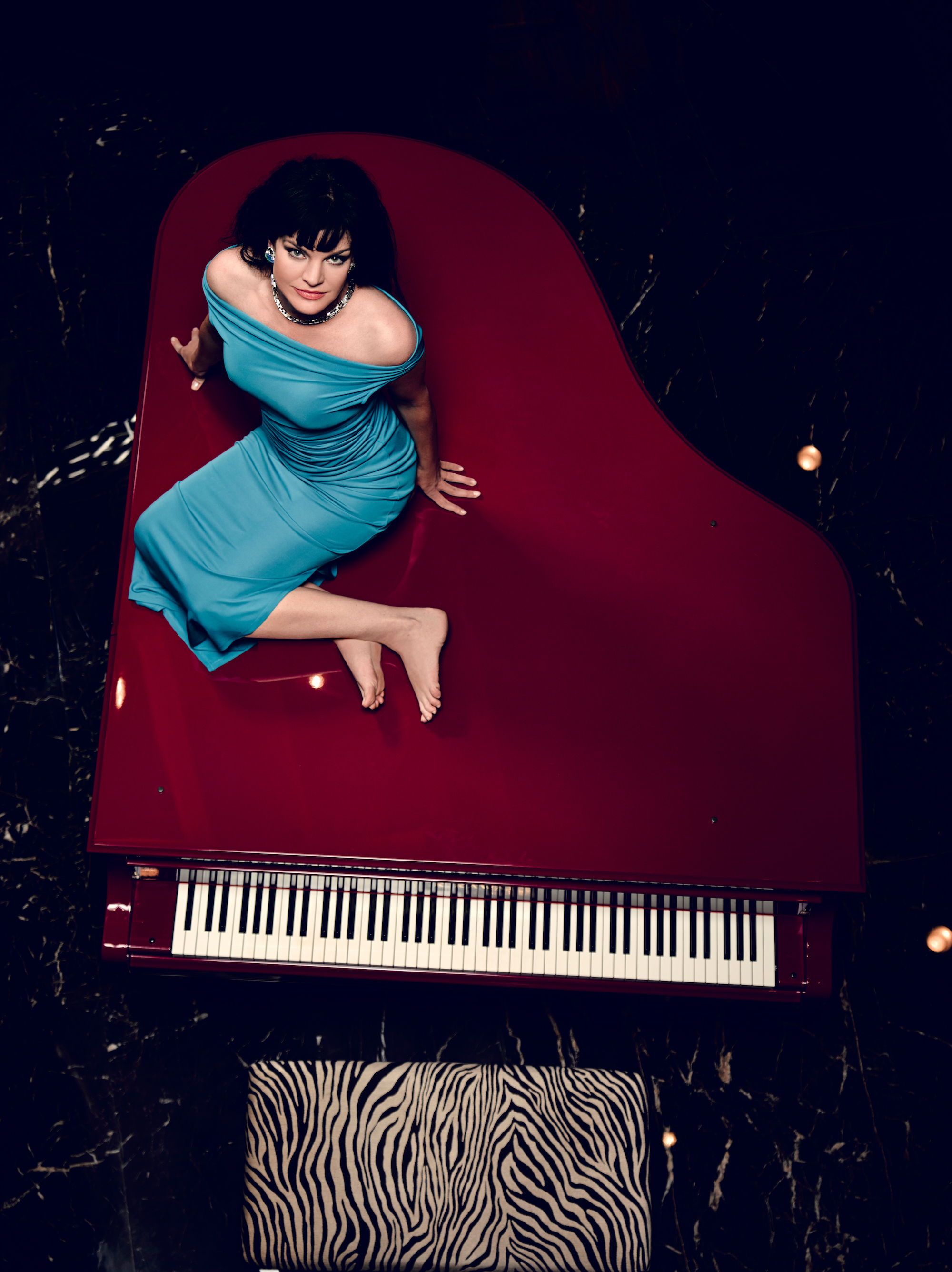 Pauley poses on a piano