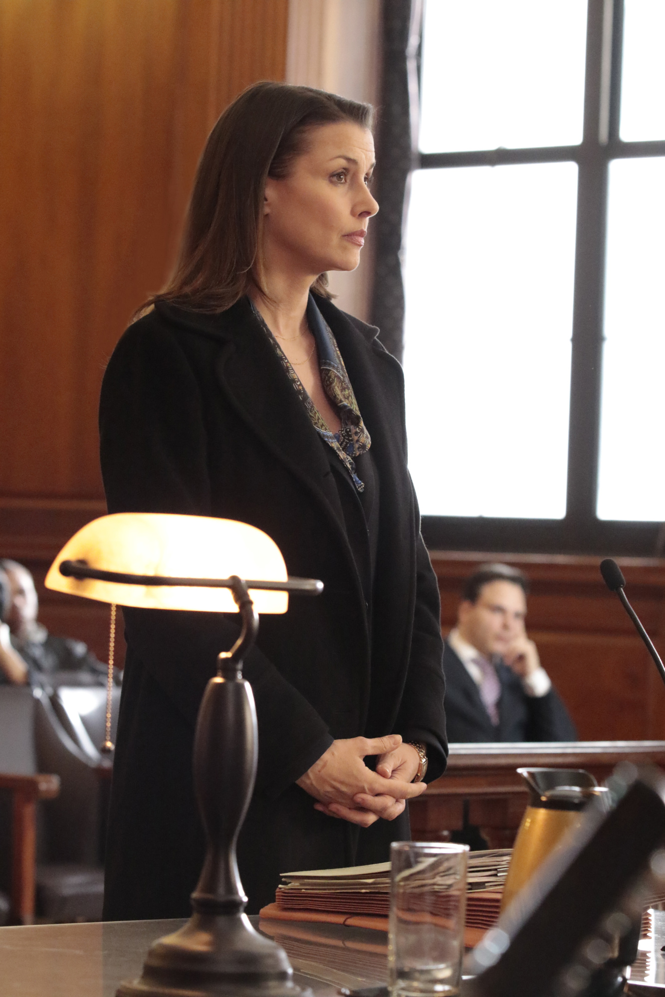 Erin Reagan stands in front of the judge.