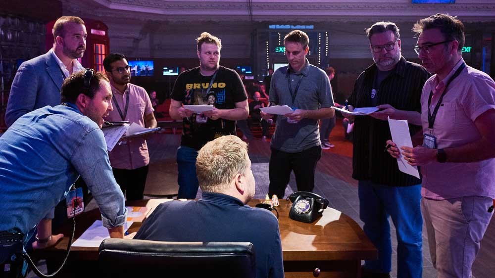 The monologue writers huddle around James Corden's desk for warmth.