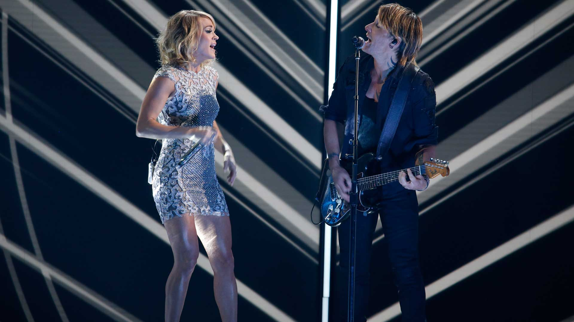 Carrie Underwood and Keith Urban perform