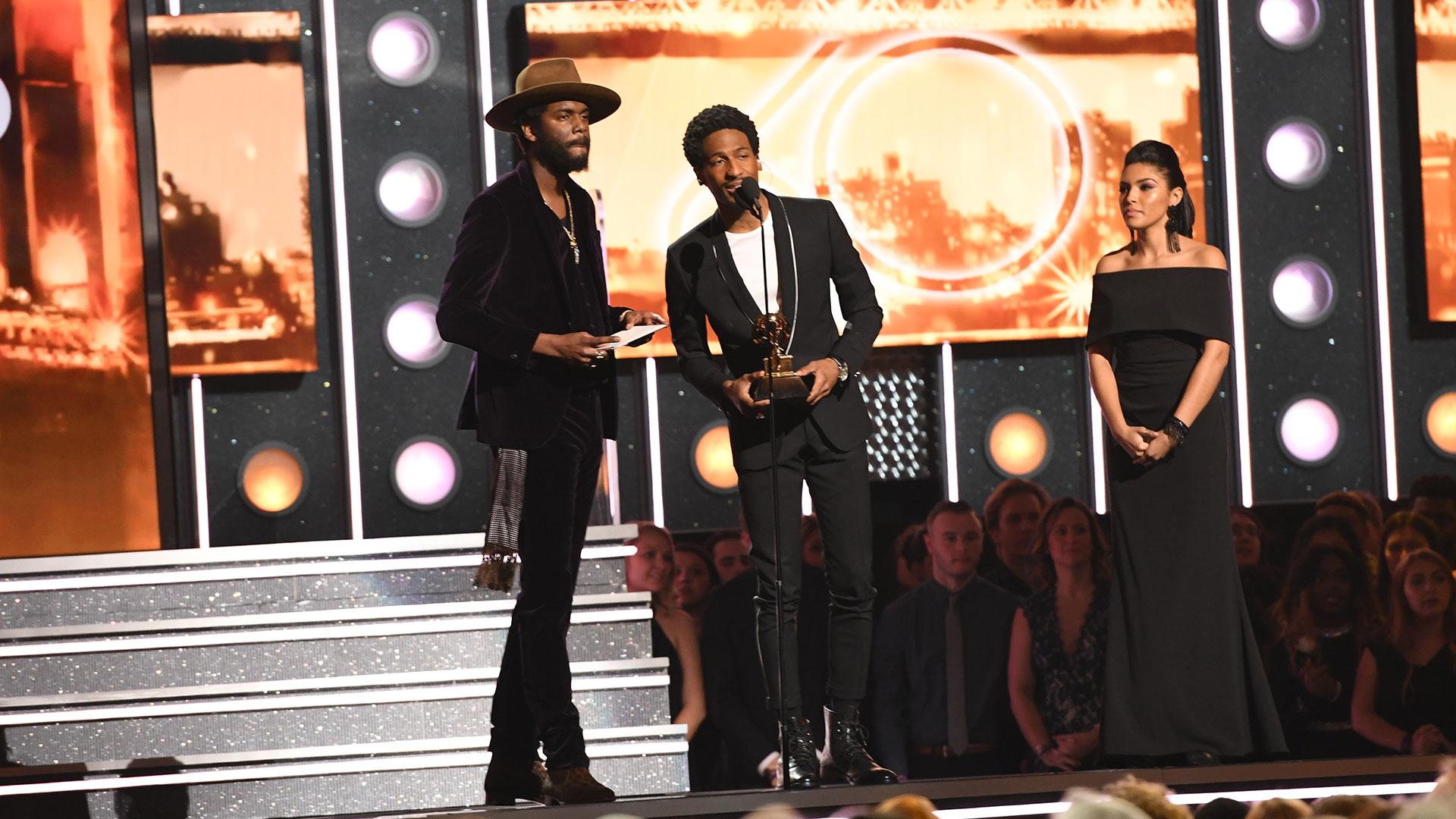 Gary Clark Jr. and Jon Batiste accept Ed Sheeran's win for Best Pop Solo Performance for