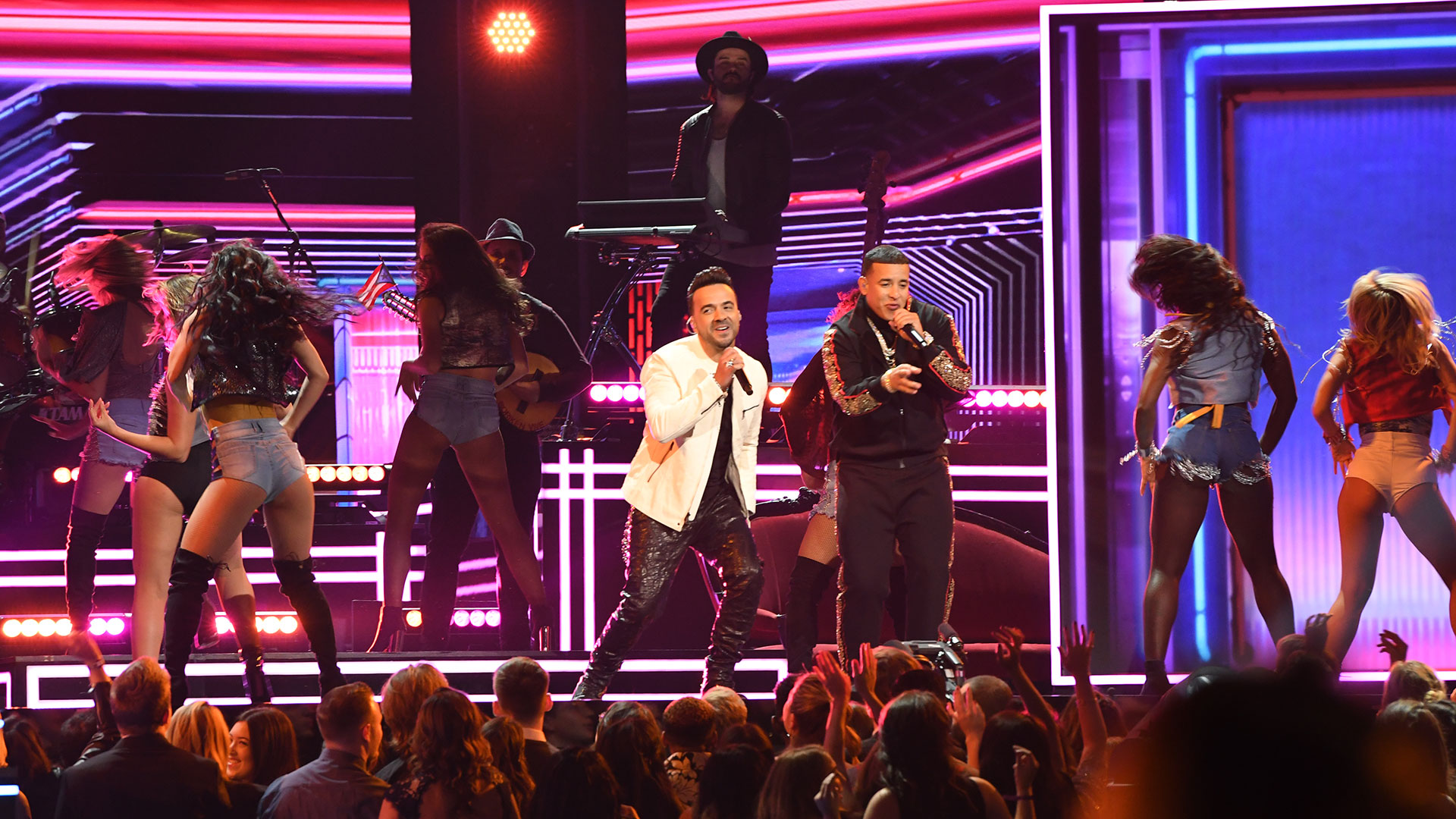 Luis Fonsi, Daddy Yankee, and Zuleyka Rivera light up the stage with their electric dance hit