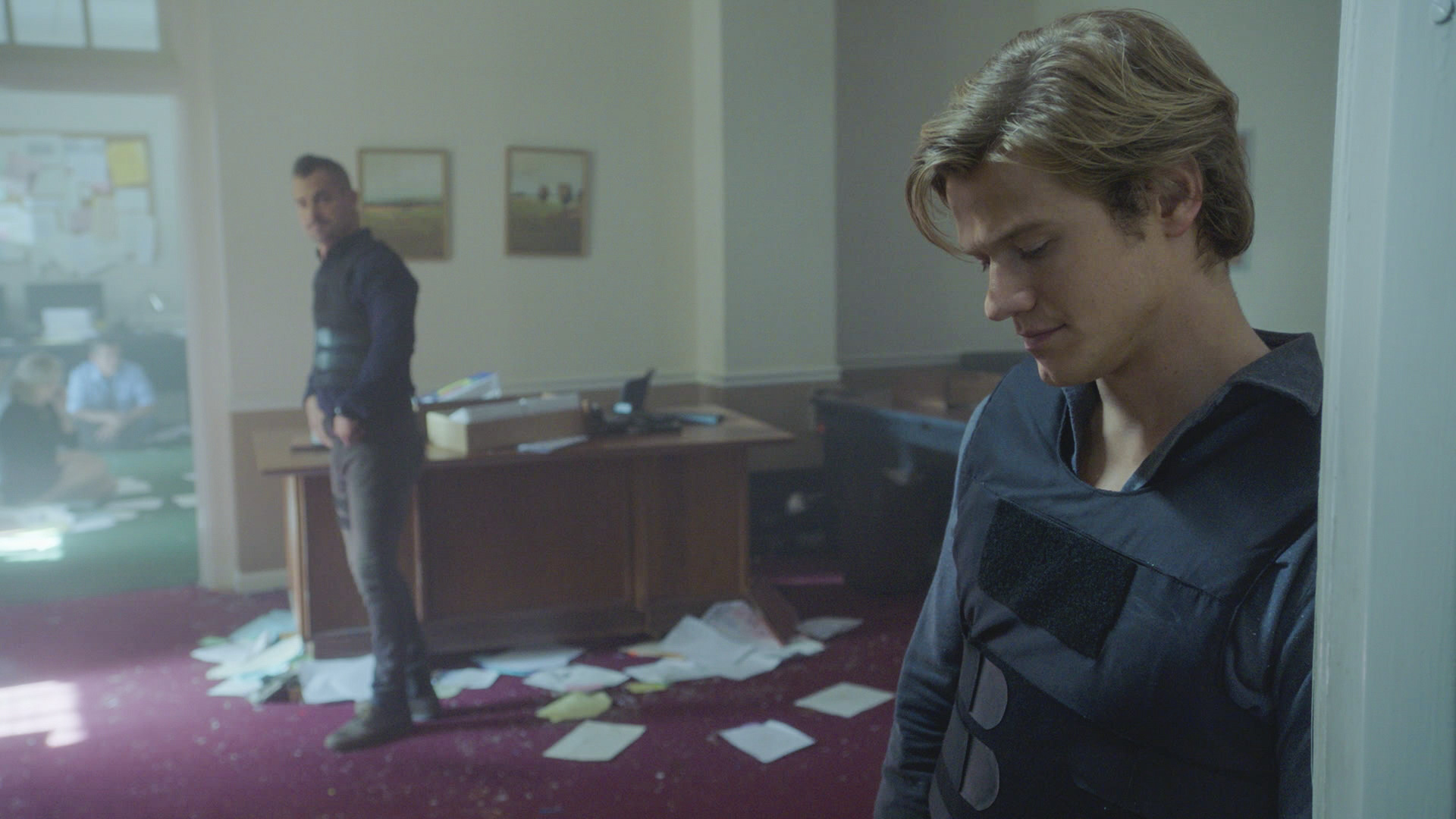 MacGyver and Jack turn the offices upside down.