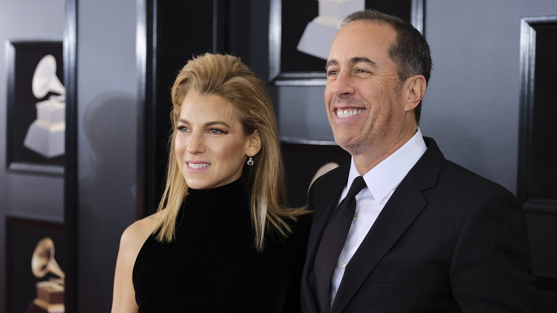 Jerry Seinfeld and wife Jessica can't stop smiling on the 60th Annual GRAMMY Awards red carpet.